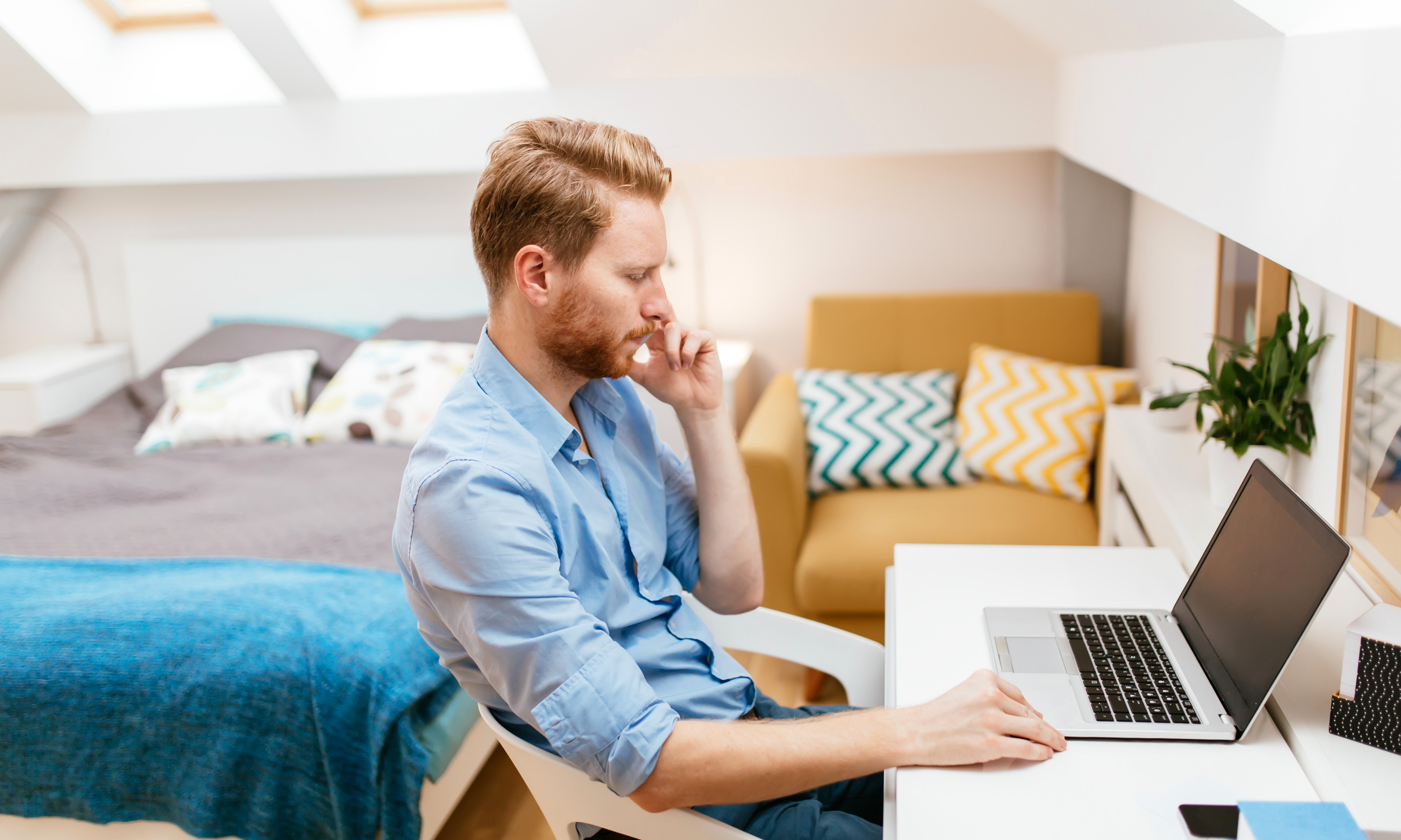 Man working from home from a vacation rental home